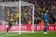 Troy Deeney (Capt) (Watford) retrieves the ball after Gerard Deulofeu (Watford) scores during the FA Cup semi-final match between Watford and Wolverhampton Wanderers at Wembley Stadium in London, England on 7 April 2019.