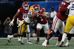 Jalen Hurts #1 of the Oklahoma Sooners runs the ball during the first half against the LSU Tigers in the 2019 College Football Playoff Semifinal at the Chick-fil-A Peach Bowl on Saturday, Dec. 28, in Atlanta. (Jason Parkhurst via Abell Images for the Chick-fil-A Peach Bowl)