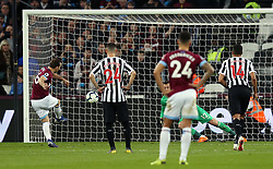 West Ham United's Mark Noble (left) scores his side's second goal of the game from a penalty during the Premier League match at London Stadium.