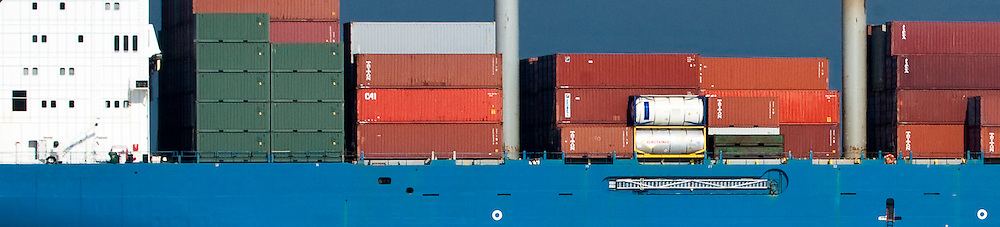 A detailed view of a container cargo ship arriving in Puget Sound, Washington, USA