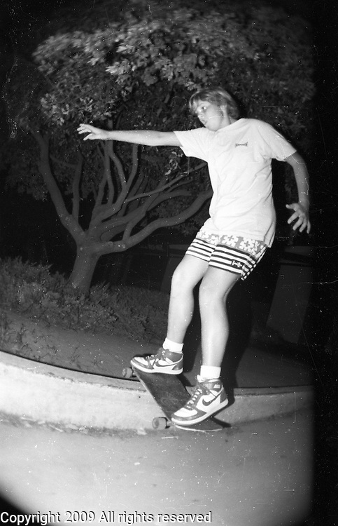 Brian Hulse rail slides during a late night skateboarding session at Monache High School in Porterville, California.