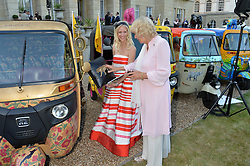 THE DUCHESS OF CORNWALL and RUTH POWYS at the Quintessentially Foundation and Elephant Family 's 'Travels to My Elephant' Royal Rickshaw Auction presented by Selfridges and hosted by HRH The Prince of Wales and The Duchess of Cornwall held at Lancaster House, Cleveland Row, St.James's, London on 30th June 2015.