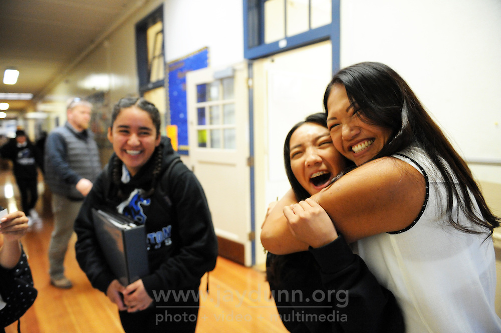 Fei Bisares hugs her daughter Sarah goodbye on Wednesday, August 3rd, the first day back to school for over 1200 students and staff at Washington Middle School, part of the Salinas Union High School District in Salinas, CA.