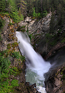 A late summer view of the lowest waterfall of Rutor, in the valley of La Thuile in Aosta valley, Italy