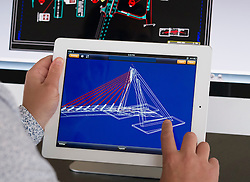 Engineer using iPad 3d CAD Computer Aided design application to model 3D design of new bridge