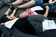 Protest against Israel's latest attack on Gaza, July 19th 2014. Students stage a die-in in Whitehall, holding papers with the names and ages of people killed in the current bombing campaign, Operation Protective Edge