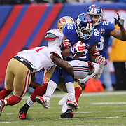 Rueben Randle, New York Giants, is tackled by Antoine Bethea, San Francisco 49ers, during the New York Giants V San Francisco 49ers, NFL American Football match at MetLife Stadium, East Rutherford, NJ, USA. 16th November 2014. Photo Tim Clayton