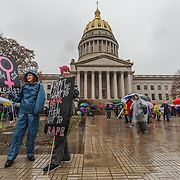 Cheri Zilla and her daughter Michaela Zilla stand outside of the Capitol building during a rally commemorating the second anniversary of the women's march in Charleston, W.Va., on Saturday, January 19, 2019.