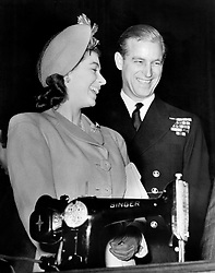Princess Elizabeth and Lieutenant Philip Mountbatten, RN at Clydebank for the launching of the liner 'RMS Caronia', stopped by at the town hall to receive the town's wedding present - an electric sewing machine.