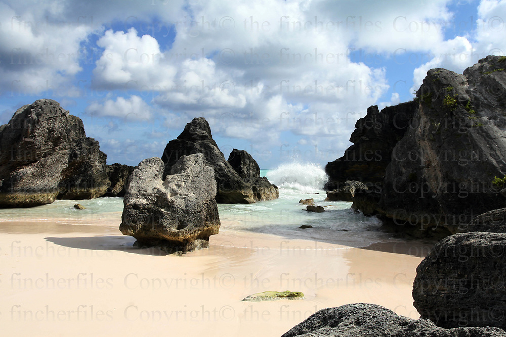 Rocks at the end of Horseshoe Bay, Bermuda as tide goes out. photograph by Jayne Fincher