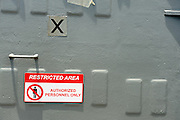 """Restricted Area"" sign on bulkhead, aboard the USS Missouri. Battleship Missouri Memorial, Pearl Harbour, Hawaii RIGHTS MANAGED LICENSE AVAILABLE FROM www.PhotoLibrary.com"