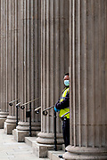 May0097093 . Daily Telegraph<br /> <br /> DT News<br /> <br /> A security guard outside the Bank of England .<br /> <br /> The City of London still hasn't recovered from the Covid pandemic as people remain working from home .<br /> <br /> London 5 October 2020