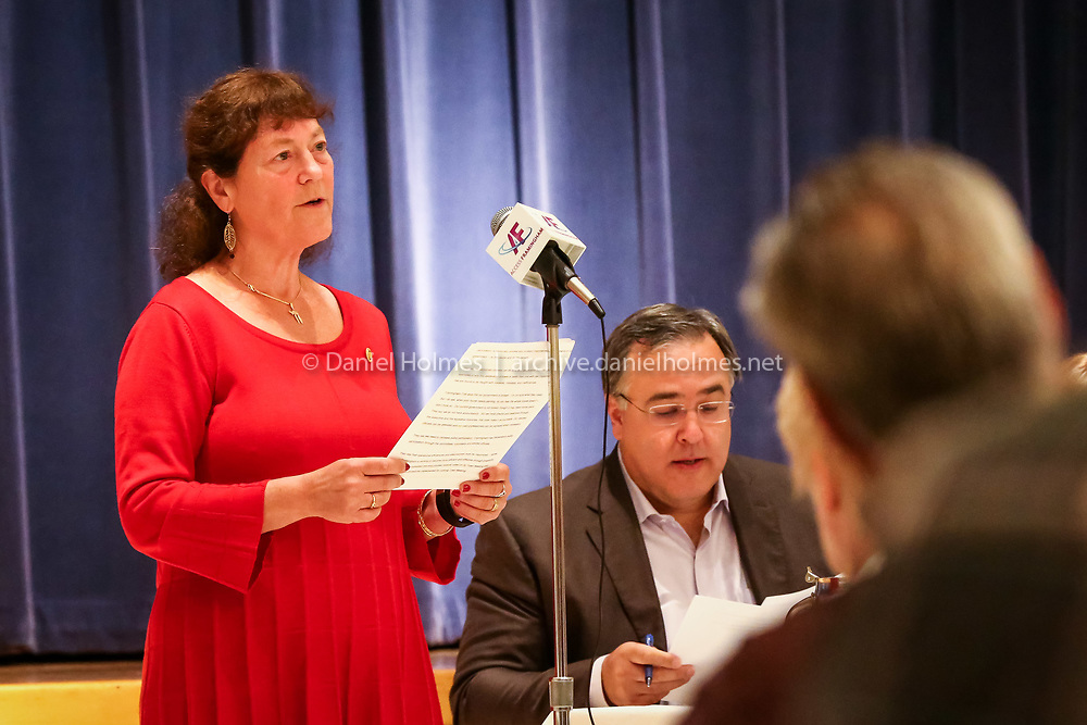 (10/18/15, FRAMINGHAM, MA) Town Moderator Teri Banerjee argues to keep Framingham a town during the debate about whether Framingham should become a city or stay a town during the Brotherhood Breakfast at Temple Beth Am in Framingham on Sunday. Daily News and Wicked Local Photo/Dan Holmes