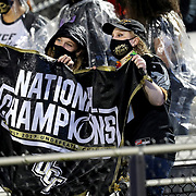 ORLANDO, FL - OCTOBER 03:  Central Florida fans hold up a national championship flag against the Tulsa Golden Hurricane at Bright House Networks Stadium on October 3, 2020 in Orlando, Florida. (Photo by Alex Menendez/Getty Images) *** Local Caption ***