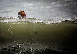 October 7, 2016 - Lake Worth, Florida, U.S. - DAVE LORICCHIO of Lake Worth swims at Lake Worth Beach in the early morning during the aftermath of Hurricane Matthew. Loricchio, who works out everyday in the ocean said, ''The current is still very strong. But it's much calmer than yesterday.'' (Credit Image: © Damon Higgins/The Palm Beach Post via ZUMA Wire)