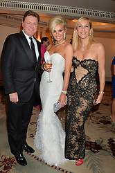 Left to right, ROD BARKER, CLAIRE CAUDWELL and TANIA BRYER at a birthday dinner for Claire Caudwell for family & friends held at The Dorchester, Park Lane, London on 24th January 2014.