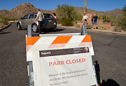 Signs at Saguaro National Park West in Tucson, Arizona, USA, indicate that the park is closed during the United States federal government shutdown effective on October 1, 2013.  The government entered a shutdown forcing furloughs of 800,000 workers and suspension of services not exempted by the Antideficiency Act.