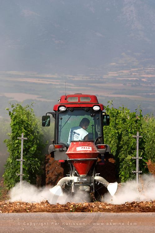 Spraying with a tractor in the vineyard. Ktima Pavlidis Winery, Drama, Macedonia, Greece