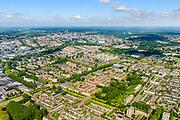 Nederland, Gelderland, Arnhem, 29-05-2019; de wijk Presikhaaf - midden met gedeeltelijk rode pannen - gezien van het Oosten, richting centrum Arnhem met Nederrijn. Winkelcentrum midden rechts, bij witte flatgebouwen op een rij en de torenflat. <br /> The Presikhaaf district - in the middle with partially red roof tiles - seen from the East.<br /> luchtfoto (toeslag op standard tarieven);<br /> aerial photo (additional fee required);<br /> copyright foto/photo Siebe Swart