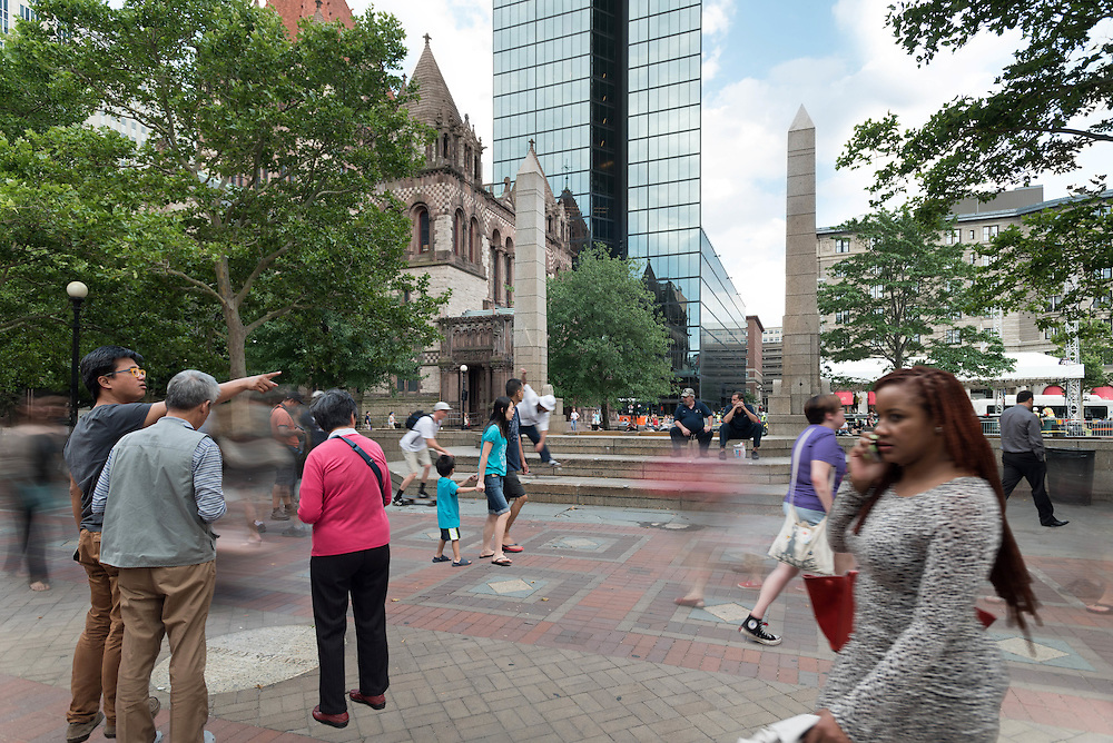 Taken Wednesday, July 22nd, 2015 from 5:55-6:30PM.  Found and © by Mike Ritter.<br /> <br /> This is the backside of the Copley Square fountain with Trinity Church and the Hancock Tower (now officially known as 200 Clarendon), two of Boston's most famous buildings, in the background.  The fountain marked the rededication of Copley Square on June 22nd, 1989, capping the Copley Square Centennial Committee's renovation efforts beginning in 1983.  Locals bustle by after work while tourists take in the famous urban park.  The stage for the Boston Summer Arts Weekend is being set which would see the performances of Aaron Neville and Emmylou Harris.  I was happy to see a few skateboarders make an entrance late in the shoot as they are regulars at the fountain in the summer – even if they're not supposed to