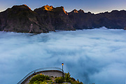 above the hidden in the clouds town of Curral Das Freiras