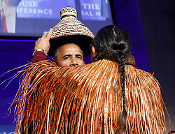 September 26, 2016 - Washington, District of Columbia, U.S. - US President BARACK OBAMA receives a traditional blanket and hat during a blanketing ceremony at the 2016 White House Tribal Nations Conference at the Andrew W. Mellon Auditorium.The conference provides tribal leaders with opportunity to interact directly with federal government officials and members of the White House Council on Native American Affairs. (Credit Image: © Aude Guerrucci/CNP via ZUMA Wire)