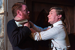 © Licensed to London News Pictures. 24/10/2014. London, England. Pictured: Matthew Pearson as Binet and Jonathan Broadbent as De Lorde. Theatre Royal Plymouth presents Grand Guignol by Carl Grose at the Southwark Playhouse, London, from 23 October to 22 November 2014. Directed by Simon Stokes with Jonathan Broadbent, Matthew Pearson, Paul Chequer, Robert Portal, Emily Raymond and Andy Williams. Photo credit: Bettina Strenske/LNP