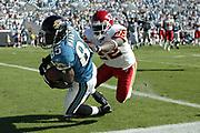 Jacksonville Jaguars wide receiver Cortez Hankton catches the game-winning touchdown as Kansas City Chiefs defensive back Dexter McCleon covers during the Jaguars 22-16 victory over the Chiefs on October 17, 2004 at Alltel Stadium in Jacksonville, FL.