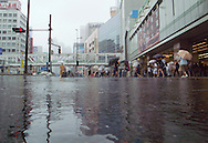 August 22, 2016 - Tokyo, Japan: At Tokyo's Shinjuku Station, the busiest train station in the city, tens of thousands or travelers were delayed or stranded due to Typhoon Mindulle hitting Tokyo. Just outside the station, sidewalks and roads were pooling up with water in nearly flood-like conditions. This typhoon, the ninth of this season, hit greater Tokyo and the outlying Kanto Plain area with the eye making landfall in neighboring Chiba Prefecture at around 12:30 p.m. Packing sustained winds of 126 kph (78 mph) and gusts as high as 180 kph (112 mph), Mindulle was the equivalent of a category 1 hurricane. It caused flooding as well as delays and cancelations to rail service including commuter lines, long distance express trains and the Shinkansen bullet train. In addition to rail disruption,s 244 flights were canceled at Tokyo's Haneda Airport. (Torin Boyd/Polaris).