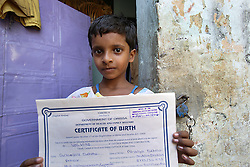 Geetanjali Behera, Age-9 years with her birth certificate.<br /> CLAP runs many programmes in this area to promote community rights and provide legal support for individuals and communities especially slum communities such as this that have no land rights.   Programme: Community Awareness Programme on Birth Registration. Brajabeharipur Community, Cuttack City, INDIA