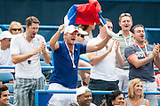 Fans supporting Russia's Dmitry Tursunov celebrate his winning the first set against USA's John Isner during their men's semifinals singles match at the Citi Open ATP tennis tournament in Washington, DC, USA, 3 Aug 2013. Tursunov won the first set 7-6 before play was suspended due to rain in the second set.