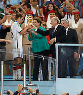 Germany's captain Philipp Lahm receives the World Cup from Brazilian President Dilma Rousseff (centre) and FIFA President Sepp Blatter during the 2014 FIFA World Cup Final match at Maracana Stadium, Rio de Janeiro<br /> Picture by Andrew Tobin/Focus Images Ltd +44 7710 761829<br /> 13/07/2014
