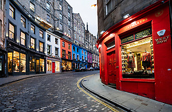 Dusk view of historic buildings and shops on Victoria Street at West Bow in Edinburgh Old town, Scotland, UK