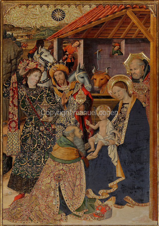 Adoration of the Magi, from the Retaule del Conestable, altarpiece of the Epiphany, 1465, by Jaume Huguet, 1412-92, commissioned by catalan king Pere IV, in catalan Gothic style, in the Capella de Santa Agueda or Chapel of Santa Agata, a catalan Gothic chapel in the Palau Reial Major, built as residence for the counts of Barcelona and kings of Aragon and now the Muhba Placa del Rei, a history museum covering Roman to medieval periods, in Barcelona, Catalonia, Spain. The chapel was built in catalan Gothic style in 1302, with a rectangular nave, polygonal apse and polychrome wooden coffered ceiling. The chapel was built by Bertran Riquer, Jaume del Rei and Pere d'Olivera for King James II of Aragon and his wife Blanca of Naples. The palace complex includes the Salo del Tinell built 1359–62, the Palatine Chapel of St Agatha built 1302 and the Palau del Lloctinent built 1549. The museum is part of the Museu de Historia de Barcelona. Picture by Manuel Cohen