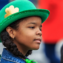 York, PA / USA - March 12, 2016: A young girl wears a green Irish derby hat at the annual Saint Patrick's Day Parade.