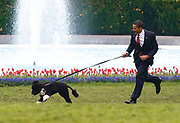 U.S. President Barack Obama runs with his new pet dog Bo, a six-month old male Portuguese water dog, on the South Lawn at the White House in Washington, April 14, 2009. REUTERS/Jim Young