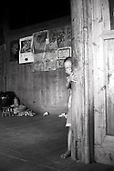 kid hiding in a house of Ping'an. Guangxi, China, Asia