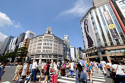 Busy pedestrian crossing  in upmarket shopping district of Ginza in Tokyo Japan