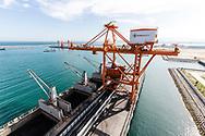Cargo unload coal at the EVN Genco 3 dockyard,  Vinh Tan coal power plant, Vietnam, Southeast Asia