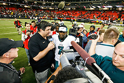 Philadelphia Eagles quarterback Michael Vick #7 is interviewed after the NFL game between the Philadelphia Eagles and the Atlanta Falcons on December 6th 2009. The Eagles won 34-7 at The Georgia Dome in Atlanta, Georgia. (Photo By Brian Garfinkel)