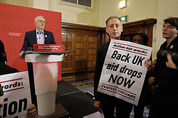© Licensed to London News Pictures. 10/12/2016. London, UK. Labour leader and the leader of opposition JEREMY CORBYN is being interrupted by protesters whilst speaking on human rights at the Methodist Central Hall in Westminster, London on Saturday, 10 December 2016. Photo credit: Tolga Akmen/LNP