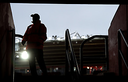 A steward guards an entrance to the stands before the Emirates FA Cup, fourth round match at St Mary's Stadium, Southampton.