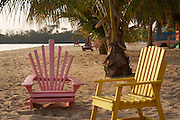 Belize, Central America - Beach chairs at the beach houses on the end of the Placencia spit