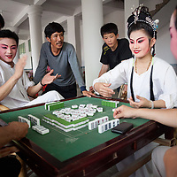 Enjoying the festive atmosphere, opera performers play mahjong during their free time before a performance at Wenxing Temple.