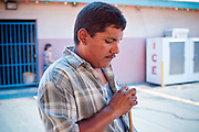 July 25 - PHOENIX, AZ: ARMANDO GUTIERREZ, originally from Mexico, chalks his pool cue during a game at El Gran Mercado. El Gran Mercado (The Big Market) in Phoenix is the largest flea market in the Phoenix area and has served the area's immigrant community for more than 20 years. With more than 150 small independent stalls selling Mexican clothes, cowboy hats, Mariachi music and food stalls selling Mexican favorites like birria chivo (goat stew) and menudo (tripe) it was more like a Mexican market than an American mall. Business in the mercado is down more than half this year because many immigrant families, legal and illegal, are leaving Arizona before the state's tough new anti-immigrant law, SB 1070 goes into effect on July 29. SB 1070 allows local police officers to check the immigration status of people they have probable cause to believe may be in the US illegally and requires immigrants to carry their immigration papers with them at all times.    Photo by Jack Kurtz