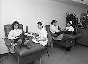 Tony Ward Gives Blood..1984.16.03.1984.03.16.1984.16th March 1984..With a possible shortage of blood over the St Patrick's Weekend,Tony Ward,Irish Rugby International,led an awareness campaign by donating blood. He attended The Blood Transfusion Service,Pelican House,Mespil Road,Dublin...Image of a young lady donor sharing a joke with a nurse as she donates blood.