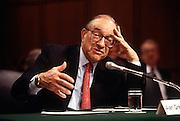 Federal Reserve Chairman Alan Greenspan testifies in Congress on bank mergers in Washington, DC.