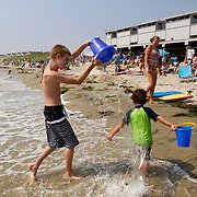 Kids play at the waters edge at Watch Hill beach in Rhode Island.