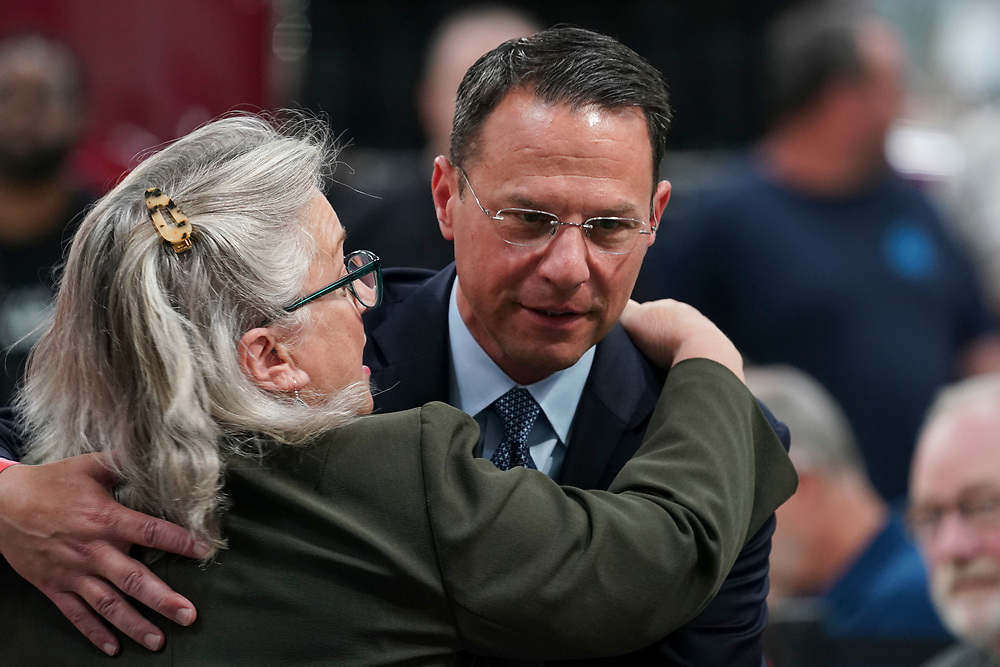Pennsylvania congresswoman Susan Wild (PA-7), left, hugs Pennsylvania Attorney General Josh Shapiro, right, as attendees gather for an appearance by President Joe Biden on July 28, 2021, following a tour of Mack Trucks Lehigh Valley Operations in Lower Macungie Township, Pennsylvania. The presidential visit was made to highlight the importance of American manufacturing, buying products made in America, and supporting good-paying jobs for American workers. (Photo by Matt Smith)