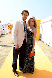 JAMES ROUSSEAU and ANNABELLE WALLIS at the Veuve Clicquot Gold Cup, Cowdray Park, Midhurst, West Sussex on 21st July 2013.